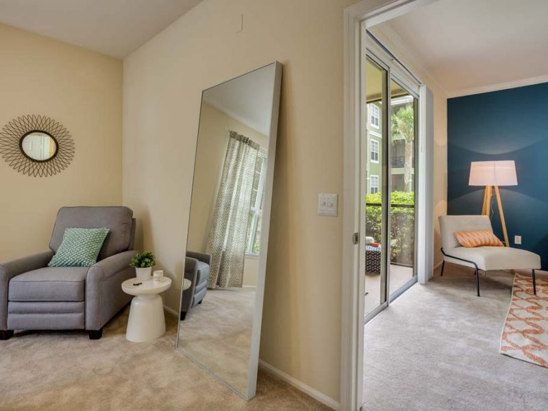 This photo exhibits the recently renovated apartment featuring the living area with a gorgeous mirror.